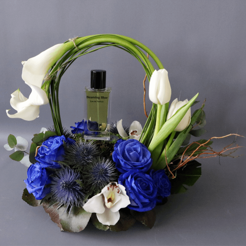 Beaming blue perfume with calla lily and tulips and blue roses