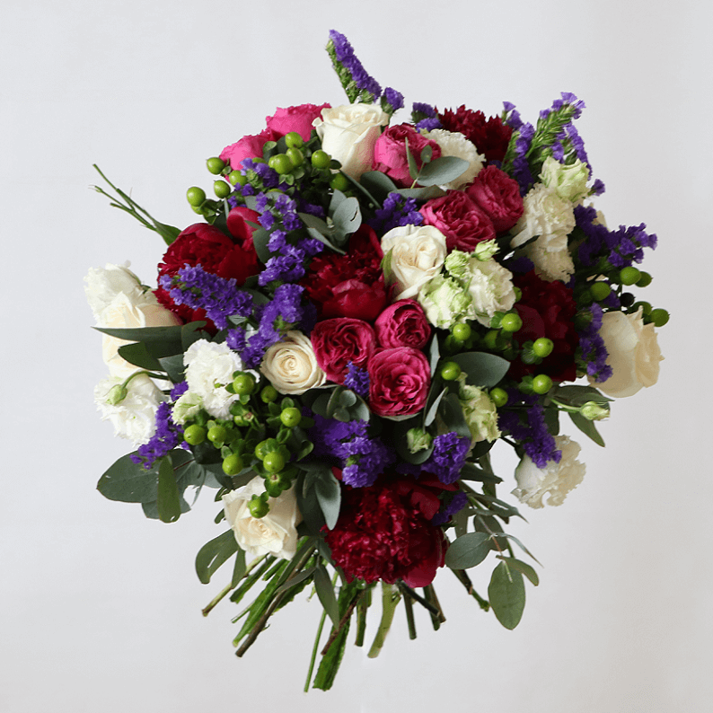 purple, pink and white bouquet of roses and spray roses