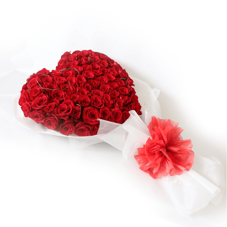 flat bouquet of red roses in a heart shape with white paper and red ribbon