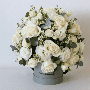 white roses, eustoma and eucalyptus arranged in a Plaza hollandi hat box