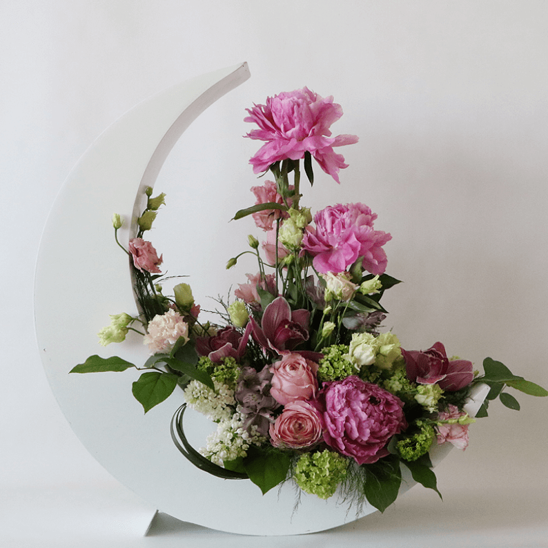 pink peonies, pink flowers, and green in a white crescent moon