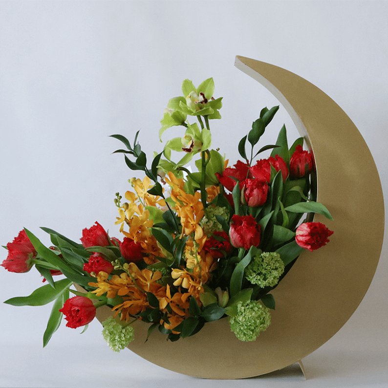 red tulips nad orchids in a gold crescent moon