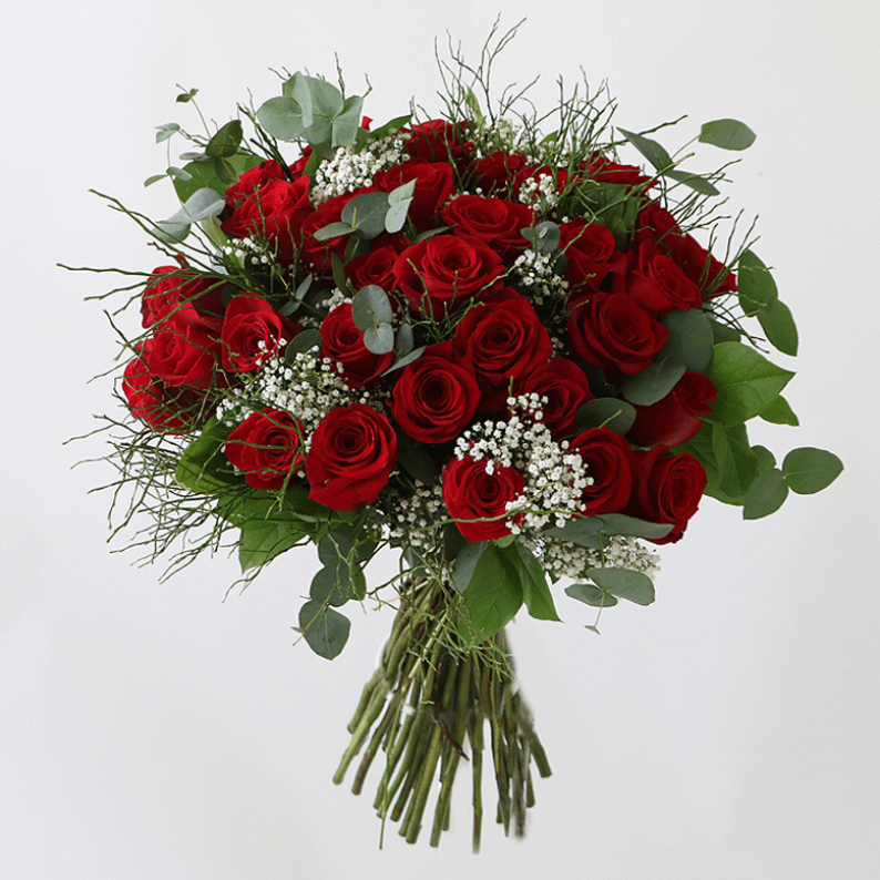 red roses and gypsophelia in a bouquet