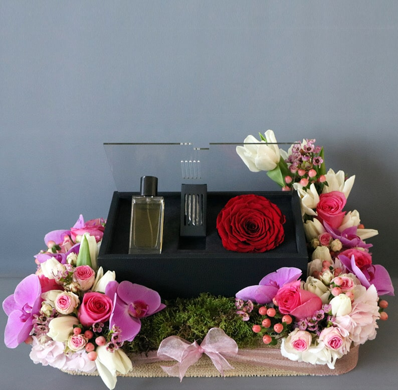 perfume and perfume box in flower arrangement