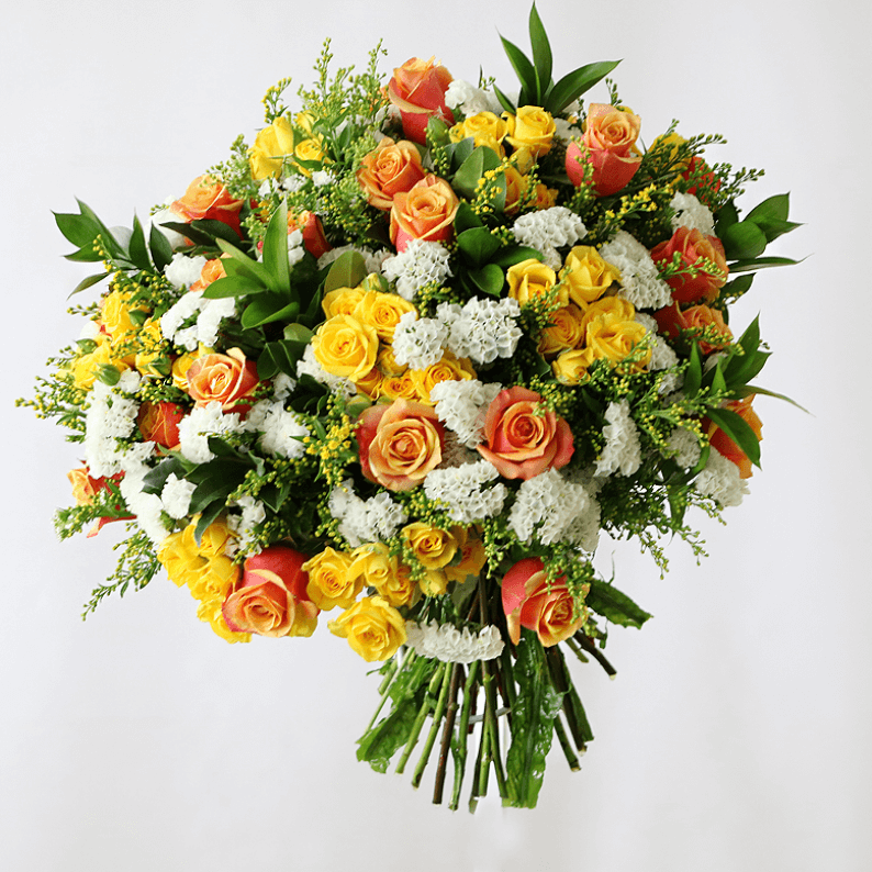 yellow, orange, and white bouquet of roses and spray roses and statice