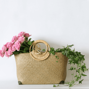 rattan basket filled with pink roses and ivy