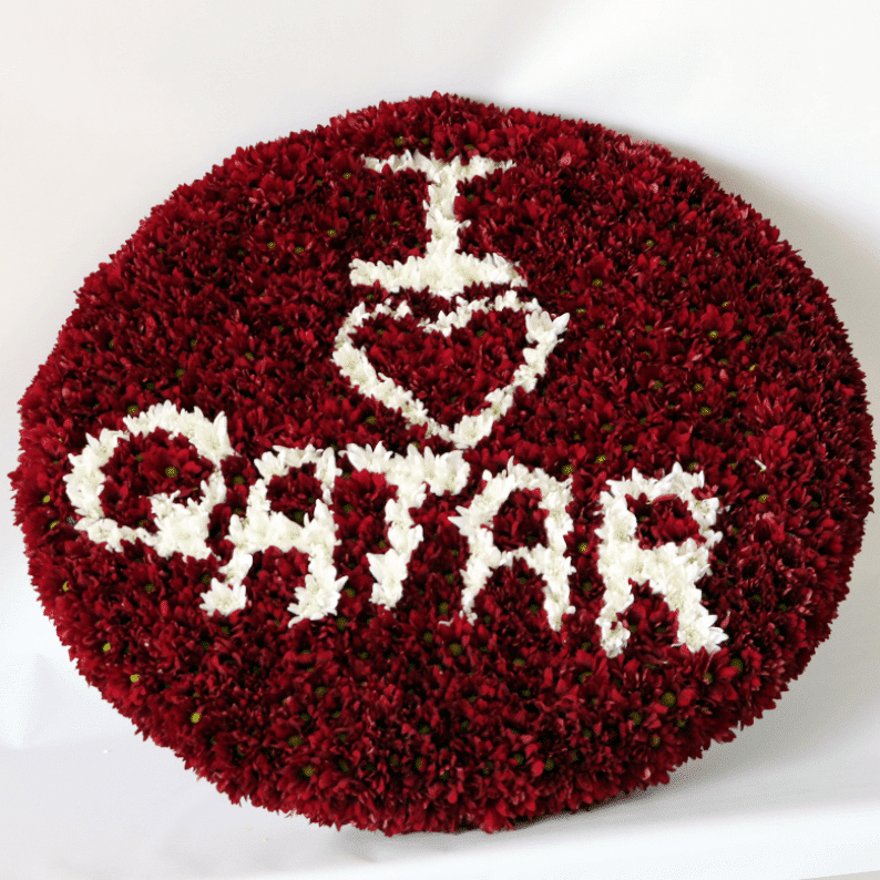 Chrysanthemums maroon and white with I love Qatar written in flowers