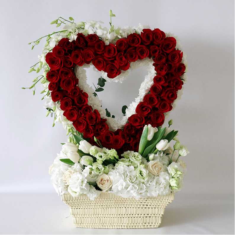 red rose heart with white hydrangea, white tulips in a basket