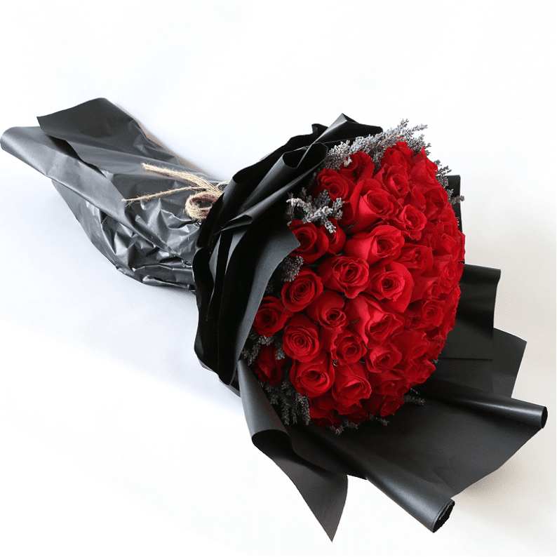 a huge red rose bouquet surrounded by lavender with black paper