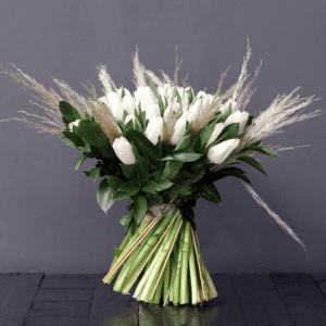 white tulips and pampas grass in a bouquet