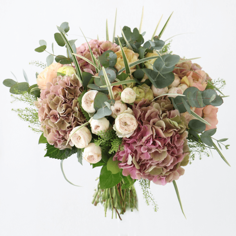 pink and green hydrangeas, spray roses and eucalyptus in a bouquet
