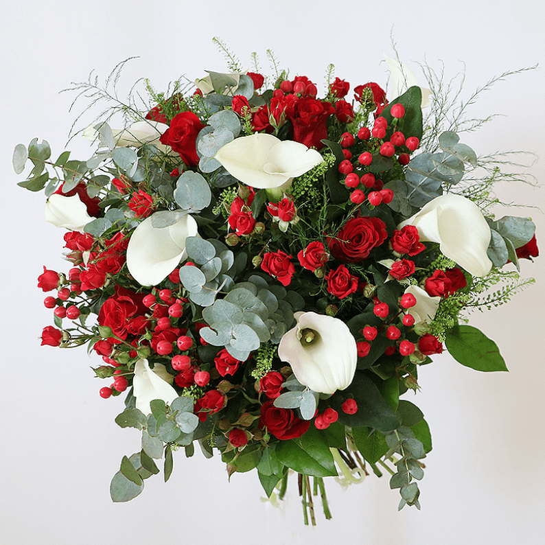 Red spray rose, red hypericum and white calla lily bouquet