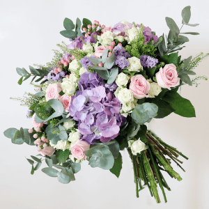 Purple hydrangea, pink rose, white spray rose, pink hypericum bouquet