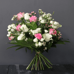 pink and white bouquet with roses, spray roses and wax flower