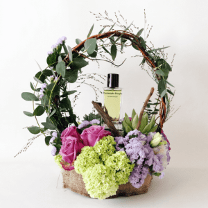 Passionate purple perfume in an arrangement with purple roses, snowball and statice