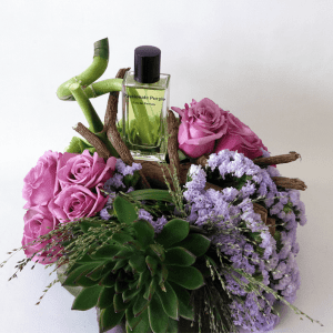 Passionate purple perfume with purple roses and succulents