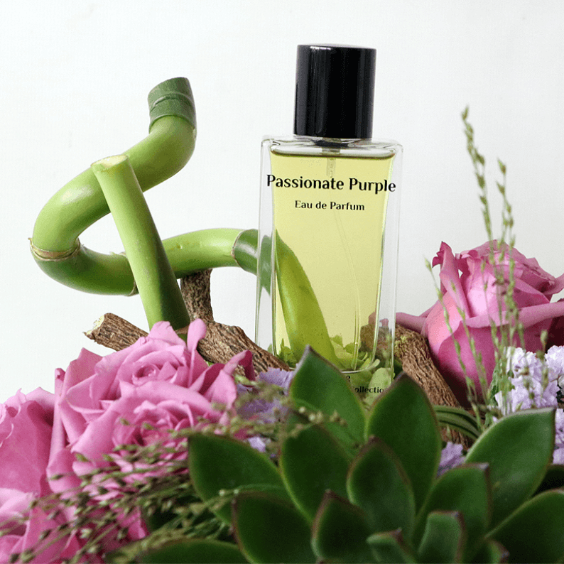 close up of passionate purple perfume with bamboo