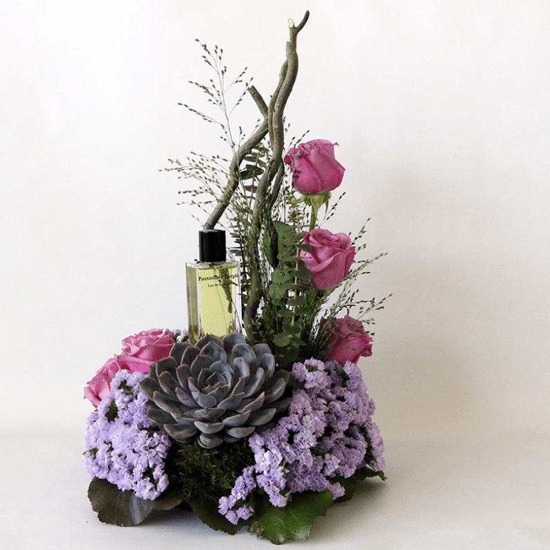 Passionate purple perfume with statice and purple roses