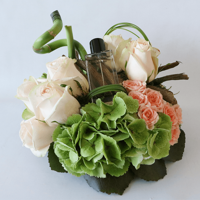 Pretty peach perfume with green hydrangea and peach roses