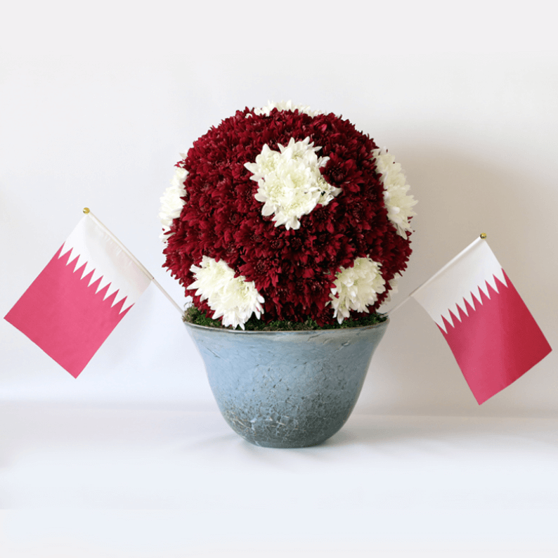 Qatar football in vase