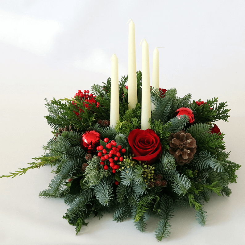 wreath arrangement with 4 long white candles