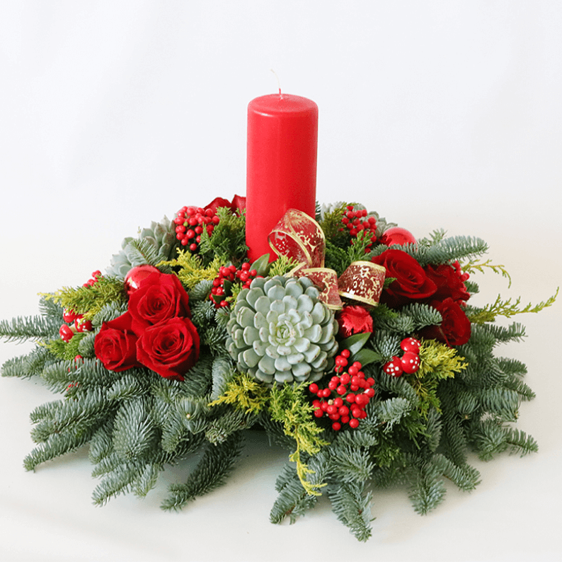 red pillar candle with succulents and red rose