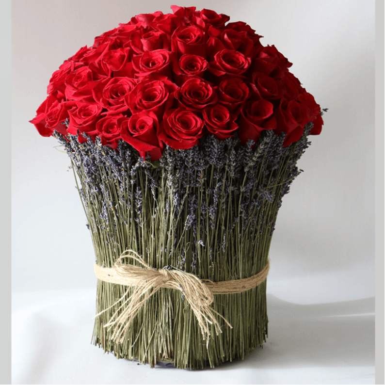 red rose bouquet surrounded by lavender