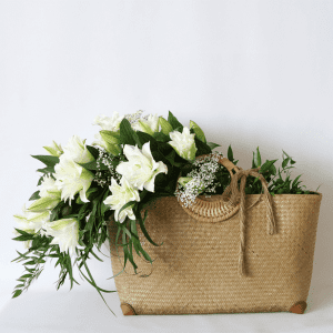 rattan basket filled with rose lily and leaves