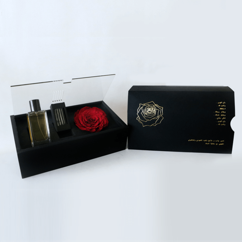 revealing red perfume in a black box with Oud and a long lasting rose amor rose