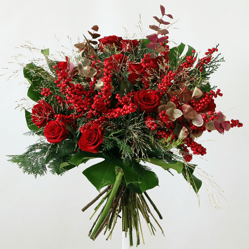 Red rose, red berries and natural greenery