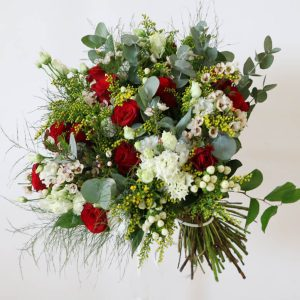 red, white and yellow bouquet with roses, eustoma, wax flower, hypericum