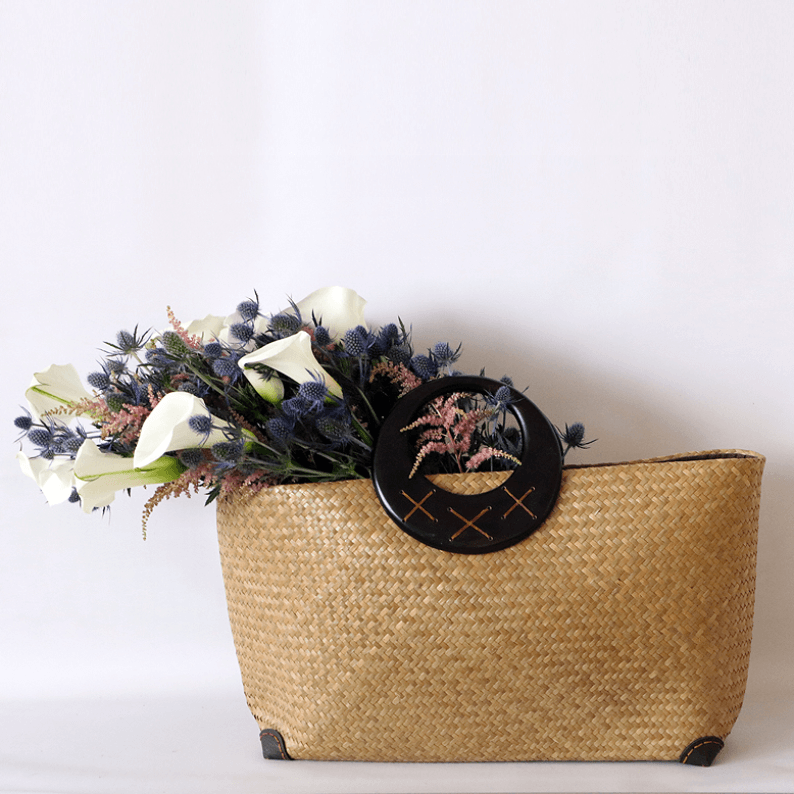 calla lily, eryngium and astilbe in a basket