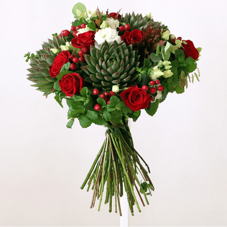 red rose, red hypericum, mint, succulents and white eustoma in a bouquet