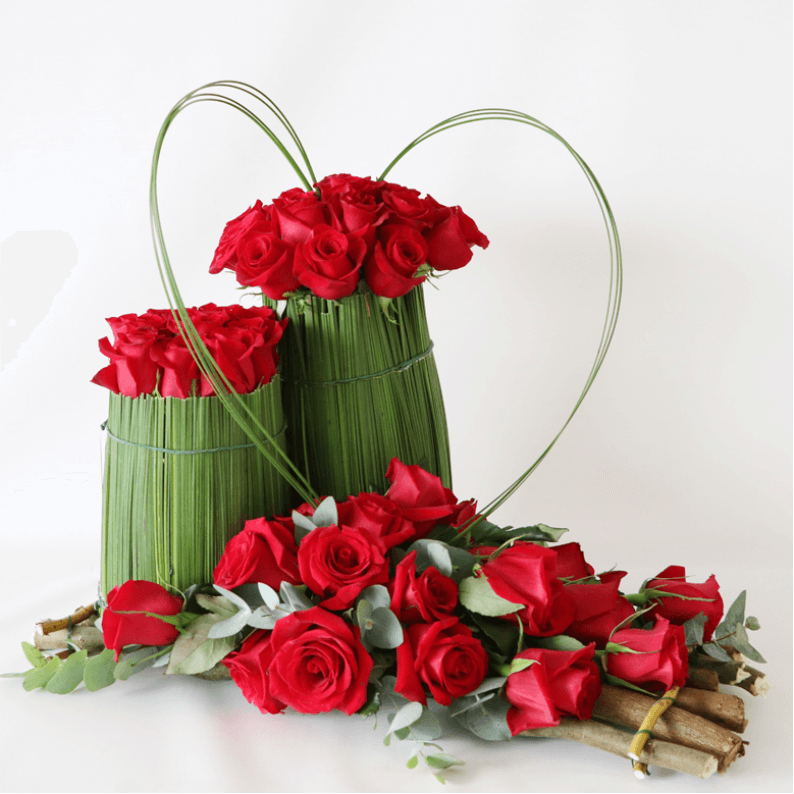 red rose and steal grass structural flower arrangement