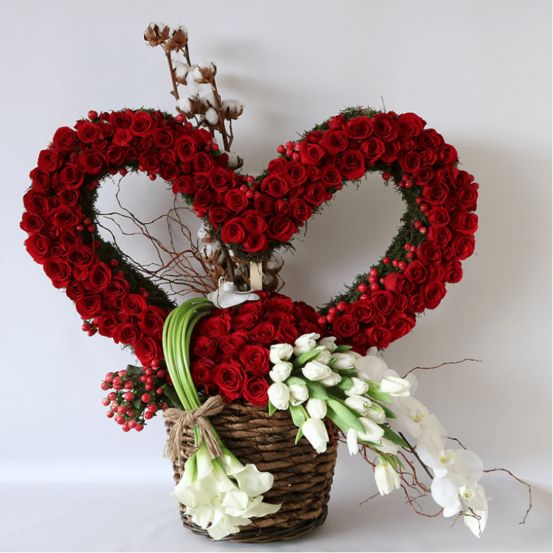 huge heart made from red roses and tulips in a basket with calla lilys
