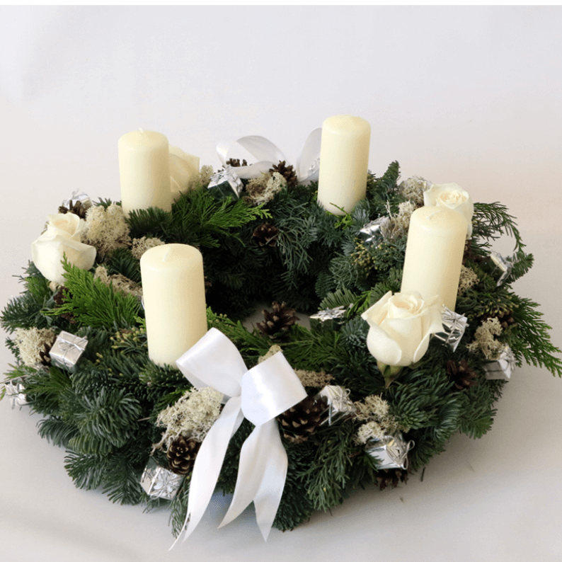 wreath arrangement with white candles