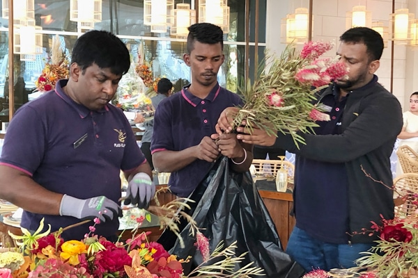 3 florists working at an event