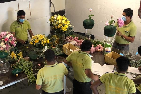 Plaza Hollandi event staff making flower arrangements