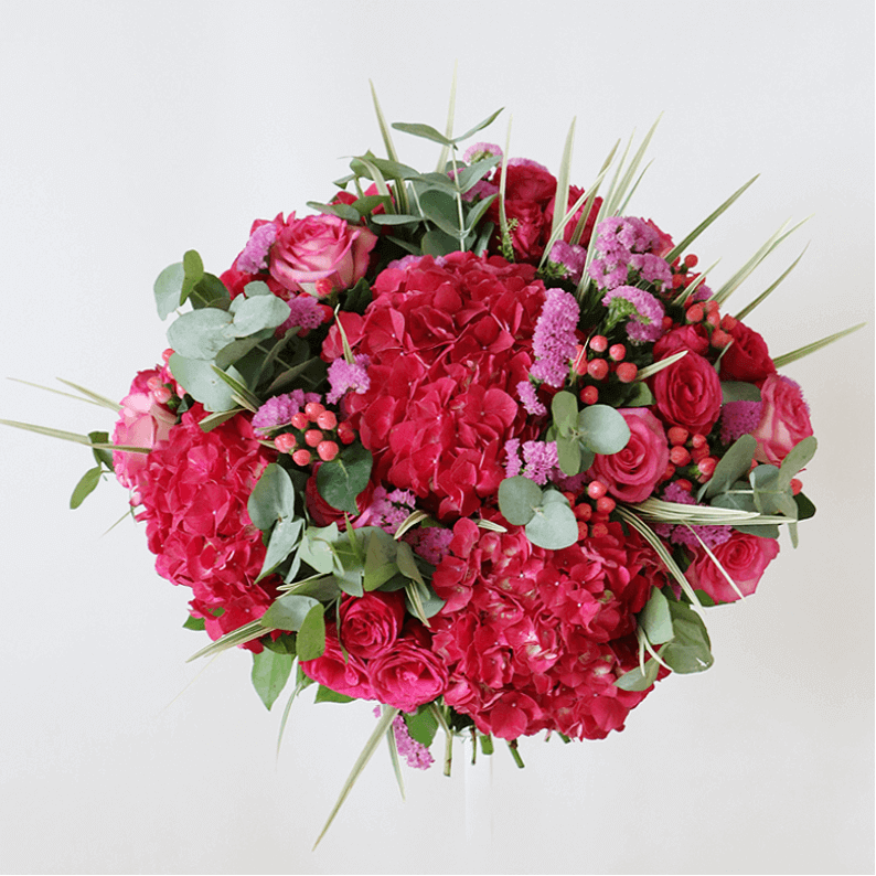 Dark pink hydrangea and pink statice with eucalyptus
