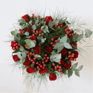 Red rose bouquet with a mix of red roses, hypericum and green leaves.