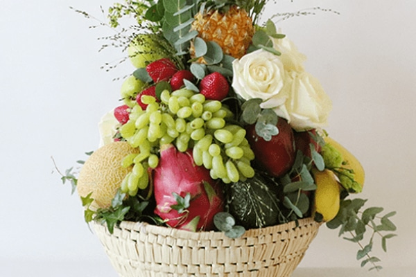 fruit basket with flowers and fruit