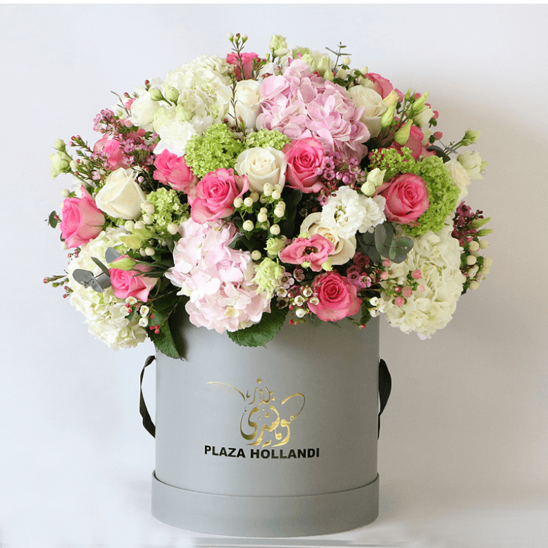 pink rose, white rose, pink hydrangea snowball arranged in a round design in a plaza hollandi hat box