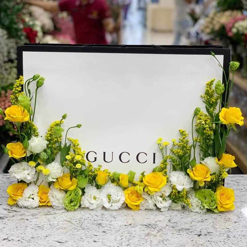 Gucci bag with yellow roses and white eustoma