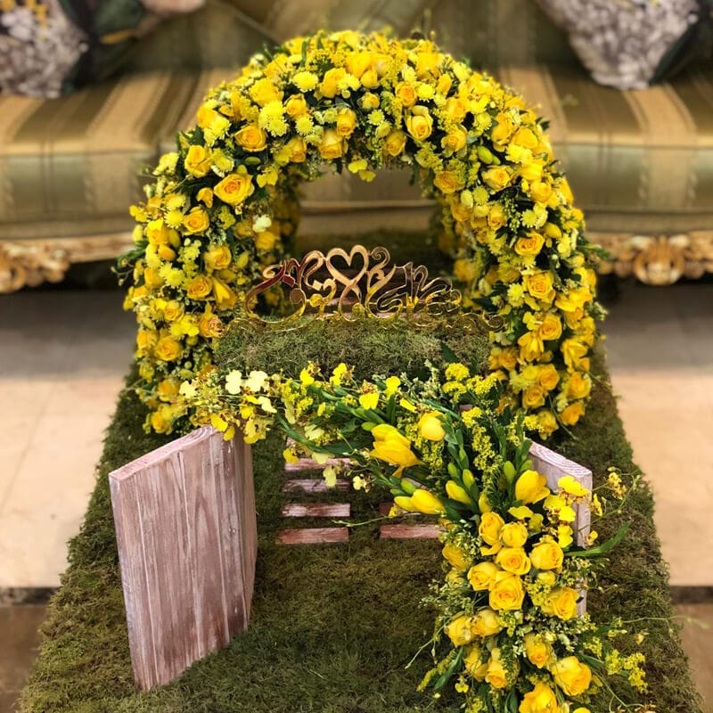 Yellow spray rose arch and moss for a customised arrangement