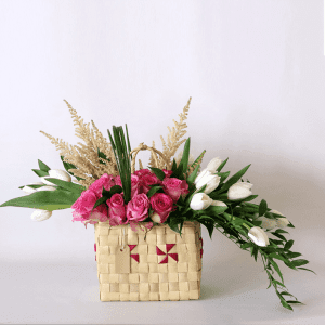 pink roses, white tulips and astilbe in a basket