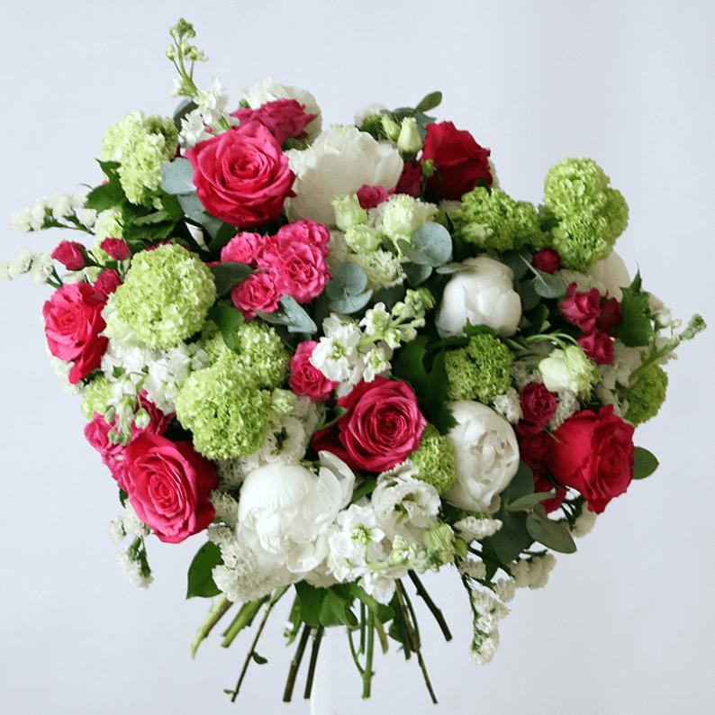 fuchia pink roses, white peonies and viburnum and stock bouquet