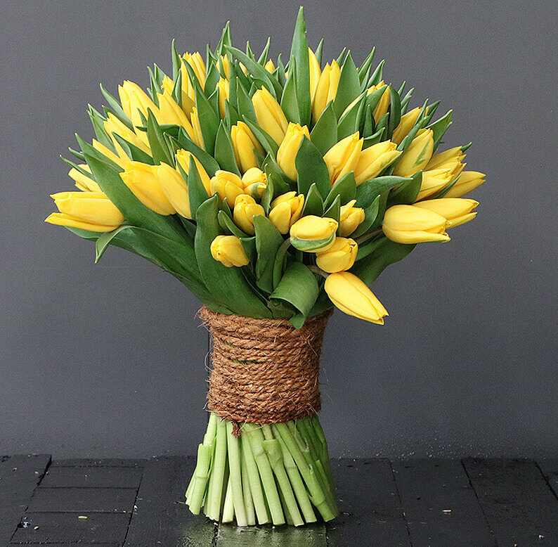 yellow tulips wrapped in rope