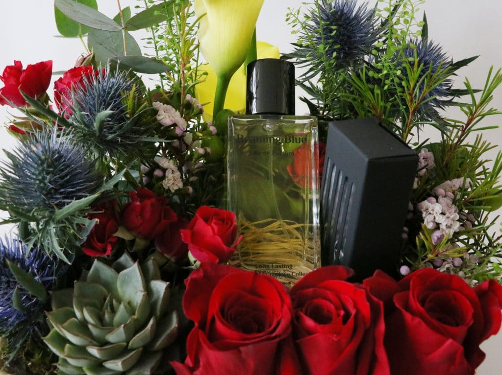 Red roses surrounding perfume