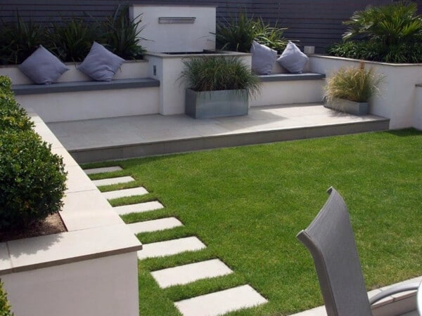 landscaped patio area with seating