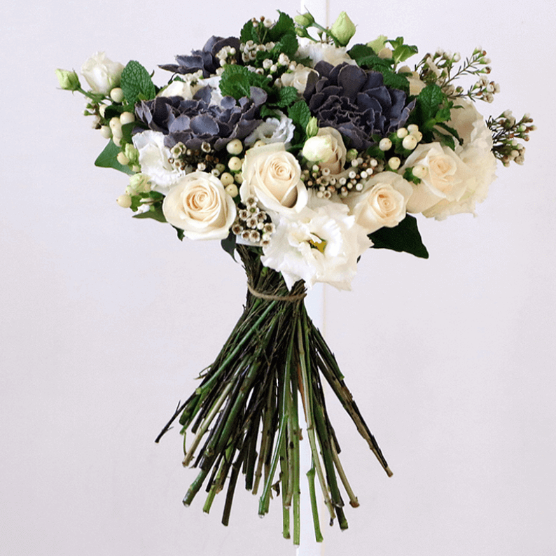 white rose, mint, eustoma and wax flower in a bouquet